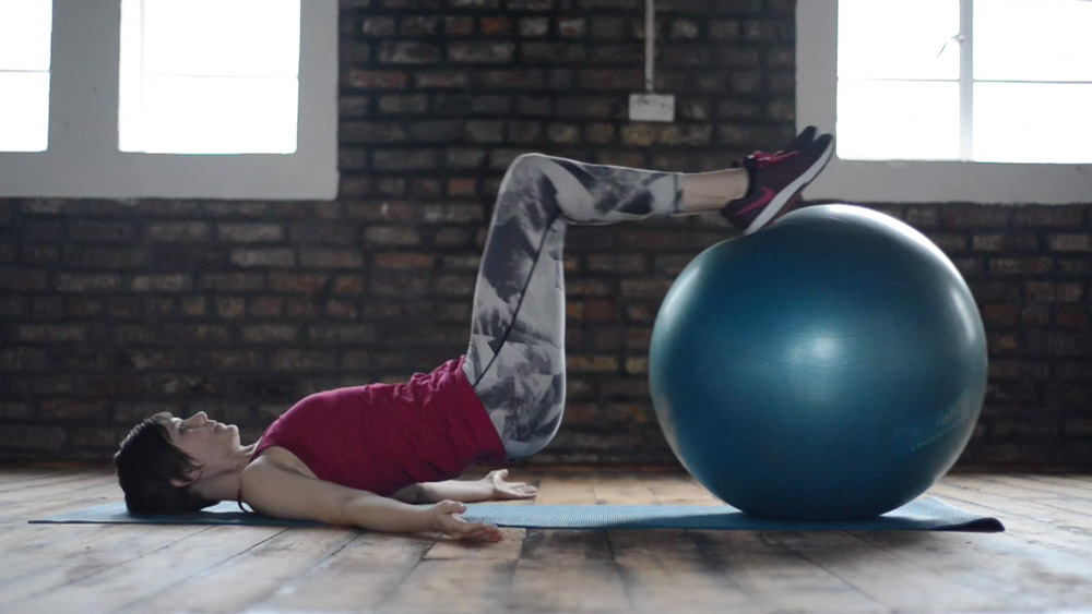 Hamstring Extension with Curl Exercise with Stability Ball
